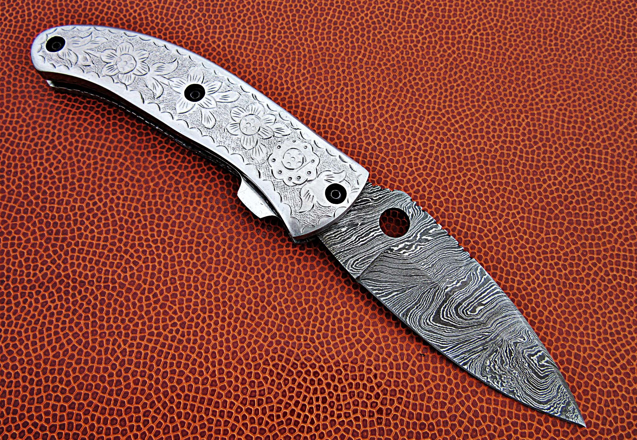 Folding knife with a metal handle